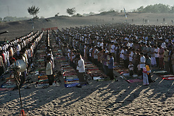 June 25, 2017 - Parangkusumo, Yogyakarta, Indonesia - Indonesian Muslims gather to perform Eid Al-Fitr prayer on sand dunes at Parangkusumo beach, Yogyakarta, Indonesia on June 25, 2017. Muslims around the world celebrate Eid al-Fitr after a month of fasting and marks the end of Ramadan. (Credit Image: © Nugroho Hadi Santoso/NurPhoto via ZUMA Press)