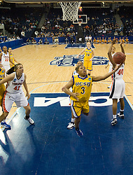 UCSB guard Chisa Ononiwu (3) shoots against UVA.  The #4 seed/#24 ranked Virginia Cavaliers defeated the #13 seed Santa Barbara Gauchos 86-52 in the first round of the 2008 NCAA Division 1 Women's Basketball Championship at the Ted Constant Convocation Center in Norfolk, VA on March 23, 2008
