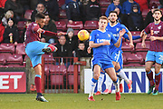 Scunthorpe United midfielder Funso Ojo (6) and Gillingham FC midfielder Jake Hessenthaler (8) during the EFL Sky Bet League 1 match between Scunthorpe United and Gillingham at Glanford Park, Scunthorpe, England on 20 January 2018. Photo by Ian Lyall.