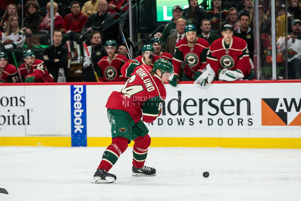 Dec 29, 2016; Saint Paul, MN, USA; Minnesota Wild forward Mikael Granlund (64) against the New York Islanders at Xcel Energy Center. The Wild defeated the Islanders 6-4. Mandatory Credit: Brace Hemmelgarn-USA TODAY Sports
