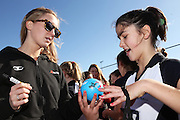 Hayley Saunders of the Tactix signs an autograph for Paris Dyer, 13 of Southbridge Netball Club during the ANZ Championship Roadshow, Win a Warmup, held at the Selwyn Netball Centre, Lincoln. 17 May 2014 Photo: Joseph Johnson/www.photosport.co.nz