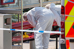 © Licensed to London News Pictures.  25/06/2018; Bristol, UK. Police forensics search a bus shelter near the scene of murder. A murder investigation has been launched after man dies and two are seriously injured in an armed burglary in Prewett Street, Redcliffe, in the early hours of the morning. It is reported that neighbours have told of hearing bloodcurdling screams of as three men were attacked with a sword-like knife. Two other men who suffered life-threatening injuries have been taken to hospital. It is reported that two men from London have been arrested in connection with the incident. Photo credit: Simon Chapman/LNP