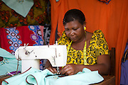Anna Nyamanda using her sewing machine to stitch a design.<br /> <br /> Anna set up and now runs a tailoring business selling a variety of home furnishings in Mwanalugali, Tanzania.<br /> <br /> She attended MKUBWA enterprise training run by the Tanzania Gatsby Trust in partnership with The Cherie Blair Foundation for Women.