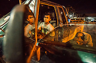 Chirtian Jorani Rios, 15, left, and his frind and co worker Arnold Josue Pastillo, right, pose for a photo at a car repair lot in Santa Rosa de Copan, Copan, Honduras, March 16, 2018. Central American Medical Outreach in Santa Rosa de Copan helps out thousands in Honduras throughout the year with medical assistance, dental, emergency operations, optometry, neurology, and much more. This May will mark their 25th Anniversary.