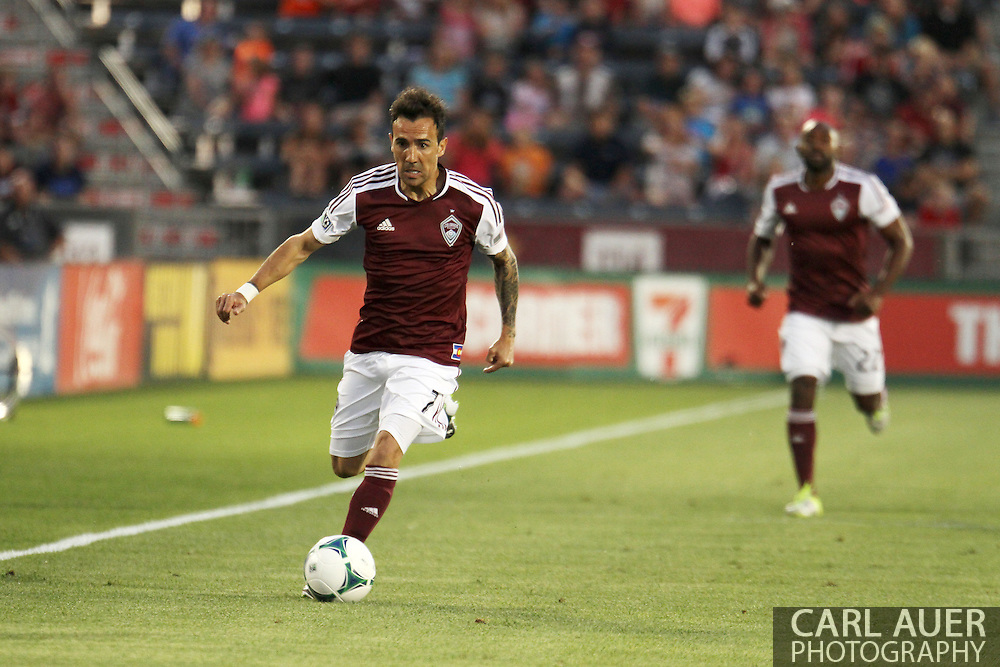 August 17th, 2013 - Colorado Rapids forward Vicente Sánchez (7) brings the ball up the pitch in the first half of the Major League Soccer match between the Vancouver Whitecaps FC and the Colorado Rapids at Dick's Sporting Goods Park in Commerce City, CO