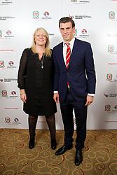 CARDIFF, WALES - Monday, October 6, 2014: Wales' Gareth Bale and Vauxhall's Cheryl Stibbs at the FAW Footballer of the Year Awards 2014 held at the St. David's Hotel. (Pic by David Rawcliffe/Propaganda)