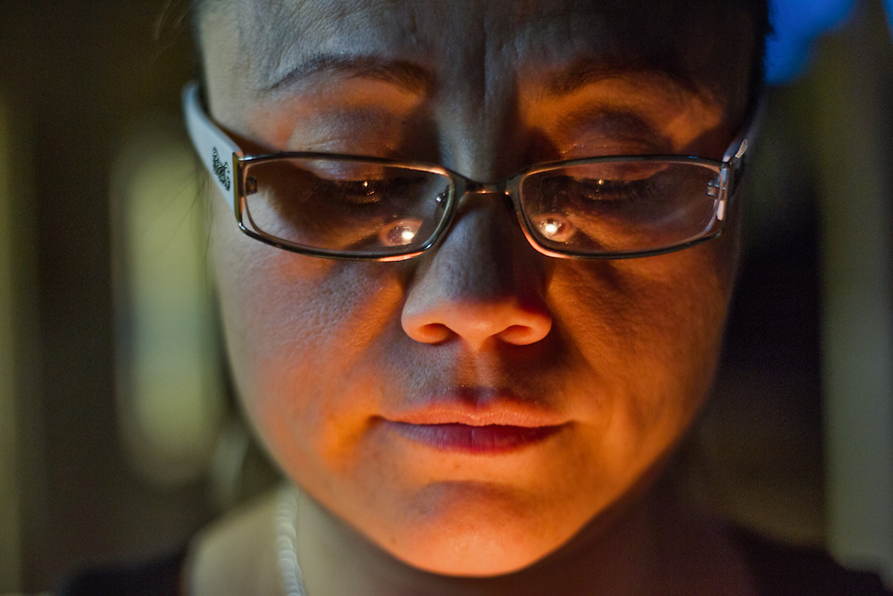 Rosa Robles looks down at her candle following a prayer and vigil, Wednesday, May 20, 2015, at the Southside Presbyterian Church in Tucson, Arizona. The church has hosted vigils for Robles every night since her taking sanctuary. Robles, age 41, moved to Tucson 16 years ago from Hermosillo, Mexico. She had taken sanctuary inside the church in August 2014 after a deportation order.