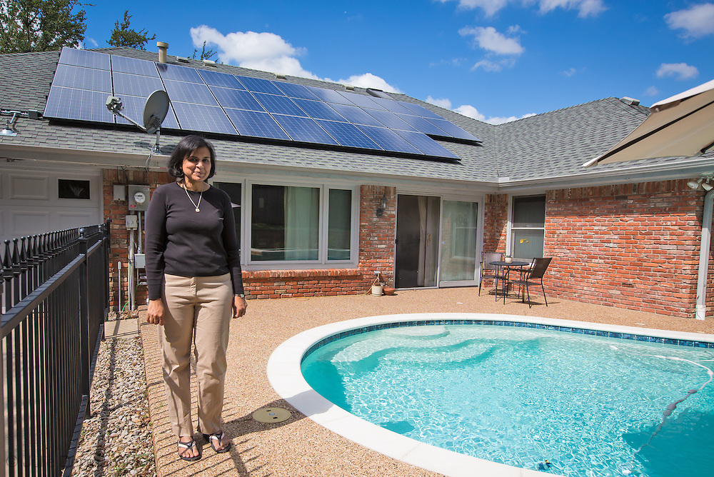Solar panels on a Home in Arlington Texas as seen from the backyard. A home owner making an effort to be energy efficient takes advantage of tax incentives to instal solar panels in Arlington Texas.
