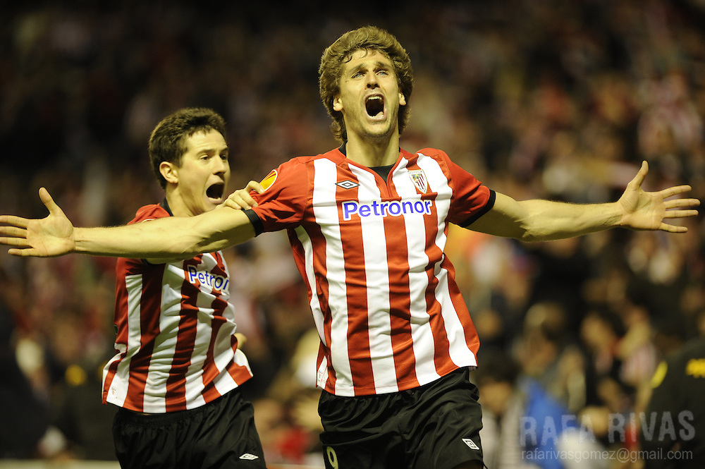 Athletic Bilbao's forward Fernando Llorente (R) and Athletic Bilbao's midfielder Ander Herrera (L) celebrate the third goal of their team, during the UEFA Europa League second leg semi-final football match Athletic Bilbao against Sporting Clube Portugal at the San Mames stadium in Bilbao on April 26, 2012. Athletic won 3-1 and qualified for the final.  PHOTO/ RAFA RIVAS