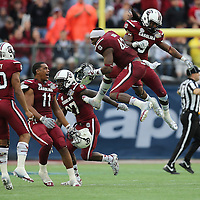 South Carolina Gamecocks linebacker Jordan Diggs (42) and South Carolina Gamecocks linebacker Sharrod Golightly (9) celebrate with other teammates during the NCAA Capital One Bowl football game between the South Carolina Gamecocks who represent the SEC and the Wisconsin Badgers who represent the Big 10 Conference, at the Florida Citrus Bowl on Wednesday, January 1, 2014 in Orlando, Florida. (AP Photo/Alex Menendez)