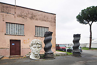"ROME, ITALY - 30 MARCH 2015: Props used in previous film productions are stocked outdoors in Cinecittà<br /> in Rome, Italy, on March 30th 2015.<br /> <br /> Italy instated a special 25% tax credit for film productions in 2010. The industry then lobbied to remove the credit's cap, and last July, Italy lifted its tax credit limit from €5 million per movie to €10 million per company per year. <br />  <br /> Cinecittà, a large film studio in Rome, is considered the hub of Italian cinema. The studios were founded in 1937 by Benito Mussolini as part of a scheme to revive the Italian film industry. In the 1950s, the number of international productions being made here led to Rome being dubbed as the ""Hollywood on the Tiber"". In the 1950s, Cinecittà was the filming location for several large American film productions like Ben-Hur, and then became the studio most closely associated with Federico Fellini.<br /> After a period of near-bankruptcy, the Italian Government privatized Cinecittà in 1997, selling an 80% stake.<br /> <br /> Currently Ben-Hur and Zoolander 2 are booked into Cinecittà Studios."