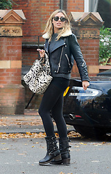 Model Abbey Clancy and footballer husband Peter Crouch out and about in London, UK. 21/10/2014<br />BYLINE MUST READ : GOTCHAIMAGES.COM<br /><br />Copyright by © Gotcha Images Ltd. All rights reserved.<br />Usage of this image is conditional upon the acceptance <br />of Gotcha Images Ltd, terms and conditions available at<br />www.gotchaimages.com