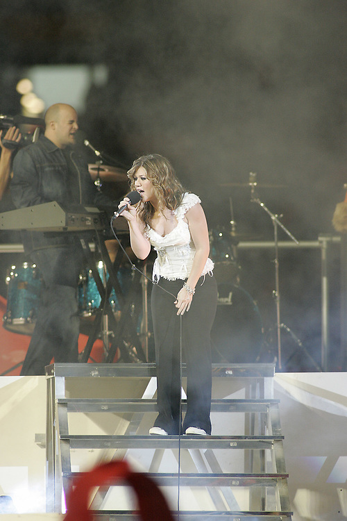 Kelly Clarkson performs during the halftime show on January 4, 2005 in the FedEx Orange Bowl at Pro Player Stadium in Miami, Florida.
