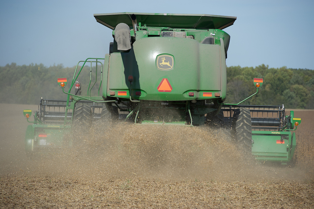 Combine harvesting grain crop on a farm