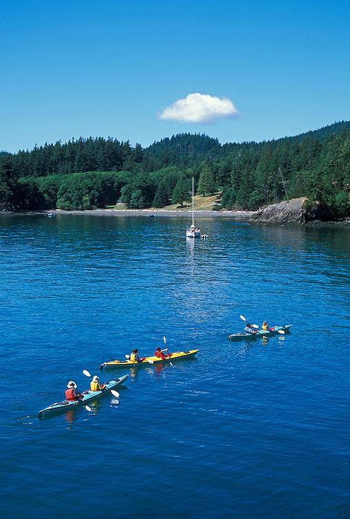 Sea kayaking at Doe Bay on Orcas Island; San Juan Islands, Washington.