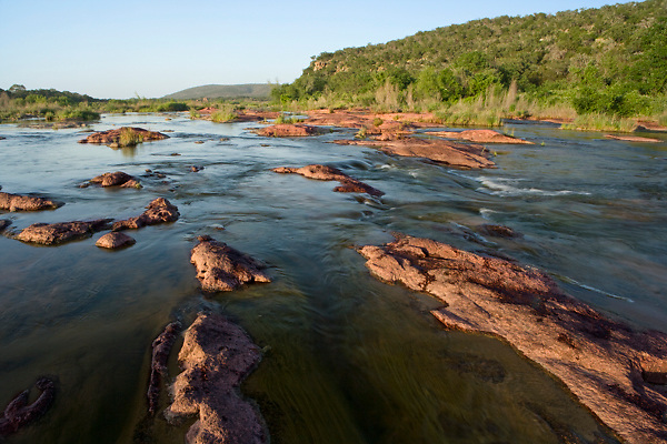 Stock photo of sunset on the Llano River in the Texas Hill Country