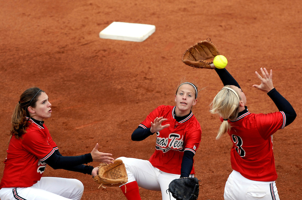 (Left to right) Texas Tech's Leah Legler (4), Liz Eimen (5), and Jennifer Bowers (3) converge on a pop fly in the infield during the first inning against Missouri on April 12, 2008.  The error advanced the Tiger's Julie Silver to first base.  Missouri beat Tech 5-3 in game one and swept the weekend series with a 10-6 win in game two.