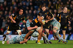 Wasps Number 8 (#8) Billy Vunipola is tackled by Leicester Flanker (#7) Julian Salvi during the second half of the match - Photo mandatory by-line: Rogan Thomson/JMP - Tel: Mobile: 07966 386802 25/11/2012 - SPORT - RUGBY - Adams Park - High Wycombe. London Wasps v Leicester Tigers - Aviva Premiership.
