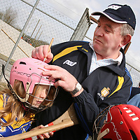 Trudy McGonigle getting her helmet signed by  Clare hurling manager Mike McNamara at the Raheen School hurling launch in Scariff on Wednesday.<br /><br />Photograph by Yvonne Vaughan.