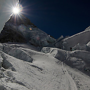 Charley Mace and Brent Bishop make their way through the chaos and danger of the upper Khumbu Icefall on Mount Everest, Nepal.