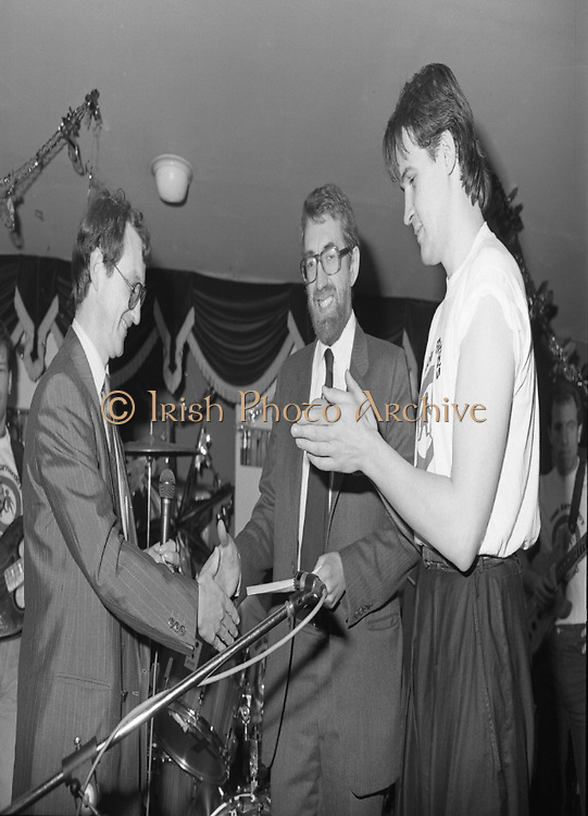 Christmas Party With Johnny Logan..1986..16.12.1986..12.16.1986..16th December 1986..At the 'Embankment',Tallaght, a charity Christmas Party was held for deprived children of the area. The main attraction was the singer and entertainer Johnny Logan,who with his band,entertained the children. Santa Claus took time off from his busy schedule to give a present to all the boys and girls. A great time was had by all.