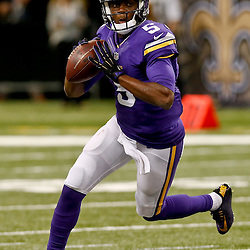 Sep 21, 2014; New Orleans, LA, USA; Minnesota Vikings quarterback Teddy Bridgewater (5) against the New Orleans Saints during the second half of a game at Mercedes-Benz Superdome. The Saints defeated the Vikings 20-9. Mandatory Credit: Derick E. Hingle-USA TODAY Sports