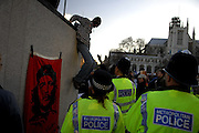 London 06/12/08 : The Campaign for Climate Change March : A man is helped down from a statue by London's Police