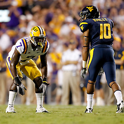 Sep 25, 2010; Baton Rouge, LA, USA; LSU Tigers cornerback Patrick Peterson (7) lines up against West Virginia Mountaineers wide receiver Stedman Bailey (10) during the first half at Tiger Stadium.  Mandatory Credit: Derick E. Hingle