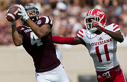 Texas A&M wide receiver Damion Ratley (4) catches a pass over Louisiana-Lafayette defensive back Lorenzo Cryer (11) during the first quarter of an NCAA college football game Saturday, Sept. 16, 2017, in College Station, Texas. (AP Photo/Sam Craft)