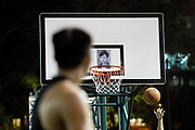 HONG KONG: 15 October 2019 <br /> A picture of Hong Kong's Chief Executive Carrie Lam is used for target practice on the backboard of a basketball hoop in the Southorn Basketball Courts in Hong Kong this evening, as basketball enthusiasts gathered in support of the pro-democracy movement which has been ongoing for 19 weeks now. <br /> Rick Findler / Story Picture Agency