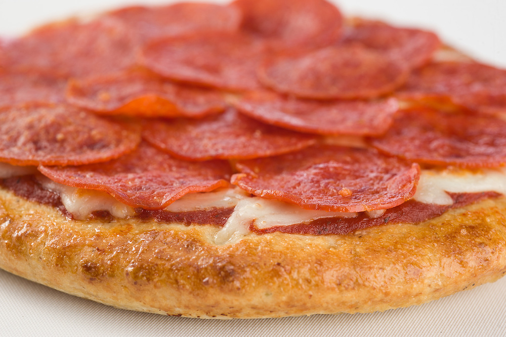 Delicious, piping hot, pepperoni pizza made from scratch by Craigos Pizza with high quality ingredients. Photograph for restaurant menu.