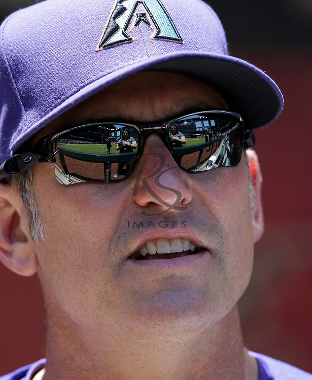 Arizona Diamondbacks manager Torey Lovullo (17) in the first inning during a baseball game against the Los Angeles Dodgers, Thursday, May 3, 2018, in Phoenix. (AP Photo/Rick Scuteri)
