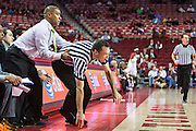 FAYETTEVILLE, AR - DECEMBER 19:  Head Coach Jason James of the UT Martin Skyhawks helps a Official up off the floor during a game against the Arkansas Razorbacks at Bud Walton Arena on December 19, 2013 in Fayetteville, Arkansas.  The Razorbacks defeated the Skyhawks 102-56.  (Photo by Wesley Hitt/Getty Images) *** Local Caption *** Jason James