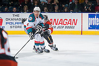 KELOWNA, CANADA - JANUARY 10: Chad Labelle #22 of Medicine Hat Tigers stick checks Madison Bowey #4 of Kelowna Rockets on January 10, 2015 at Prospera Place in Kelowna, British Columbia, Canada.  (Photo by Marissa Baecker/Shoot the Breeze)  *** Local Caption *** Chad Labelle; Madison Bowey;