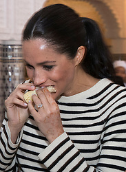 Prince Harry, Duke of Sussex, and Meghan Markle, Duchess of Sussex visit a cooking demonstration where under privileged children are learning to cook under Chef Moha Fedal at the Villa des Ambassadors in Rabat, Morocco, on the 25th February 2019. 25 Feb 2019 Pictured: Meghan Markle, Duchess of Sussex. Photo credit: MEGA TheMegaAgency.com +1 888 505 6342