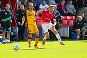 Salford City forward Adam Rooney tackled by the opponent during the EFL Sky Bet League 2 match between Salford City and Port Vale at Moor Lane, Salford, United Kingdom on 17 August 2019.
