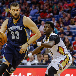 Mar 21, 2017; New Orleans, LA, USA; Memphis Grizzlies center Marc Gasol (33) drives past New Orleans Pelicans guard Jrue Holiday (11) during the first quarter of a game at the Smoothie King Center. Mandatory Credit: Derick E. Hingle-USA TODAY Sports