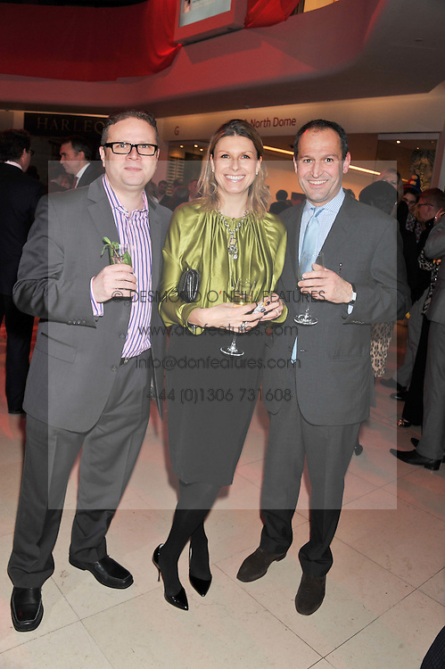 Left to right, ANTONY BURNS, BEVERLEY SPYER and MATT GOMEZ at the London Design Week 2013 Party, held at the Design Centre, Chelsea Harbour, London SW10 on 18th March 2013.