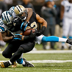 Dec 7, 2014; New Orleans, LA, USA; Carolina Panthers outside linebacker Thomas Davis (58) tackles New Orleans Saints running back Mark Ingram (22) during the first half of a game at the Mercedes-Benz Superdome. Mandatory Credit: Derick E. Hingle-USA TODAY Sports
