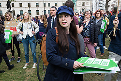 London, UK. 1st May, 2019. Amelia Womack, Deputy Leader of the Green Party, joins climate protesters attending a Declare A Climate Emergency Now demonstration in Parliament Square organised to coincide with a motion in the House of Commons to declare an environment and climate emergency tabled by Leader of the Opposition Jeremy Corbyn. The motion, which does not legally compel the Government to act, was passed without a vote.