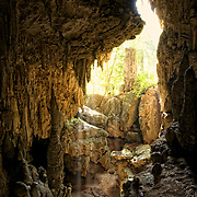 Tham Mae Usu or Mae Usu Cave in Tak province, Thailand. This cave is famous for its magnificent and beautiful stalactites and stalagmites as well as the access to the cave being in a river, therefore the cave is only accessible during the dry season.