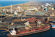 Nederland, Noord-Holland, IJmuiden, 11-12-2013; Tata Steel, zicht op de cokesfabriek en de laatste 2 hoogovens (re). Links bulkcarrier en opslag van kolen, cokes, erts. Voorheen Corus, Hoogovens<br /> Tata Steel, view of the coke plant and the last two blast furnaces. To the left bulk carrier and storage of coal, coke, ore. Formerly Corus Hoogovens<br /> luchtfoto (toeslag op standaard tarieven);<br /> aerial photo (additional fee required);<br /> copyright foto/photo Siebe Swart.