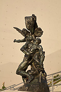 La Defense, 1879, sculpture by Auguste Rodin, 1840-1917, remade in bronze in 2017 by the Fonderie de Coubertin in Saint-Remy-les-Chevreuse, on the staircase of La Seine Musicale, a music and performing arts centre, opened April 2017, on the Ile Seguin in the river Seine, between Boulogne-Billancourt and Sevres, in the Western suburbs of Paris, France. The statue depicts a winged woman with arms raised and fists clenched, leaning on a dying warrior, representing courage and resilience. The complex includes La Grande Seine, a large concert hall seating 6000 with a rotating solar panel fin, an auditorium for unamplified classical music, event or exhibition spaces and the Bellini Gardens. Picture by Manuel Cohen
