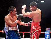 Blood sprays from the face of Marco Antonio Barrera as Amir Khan lands a left during the WBA and WBO Inter-Continental Lightweight title fight between Amir Khan and Marc Antonio Barrera at the MEN Arena on March 14, 2009 in Manchester, England.