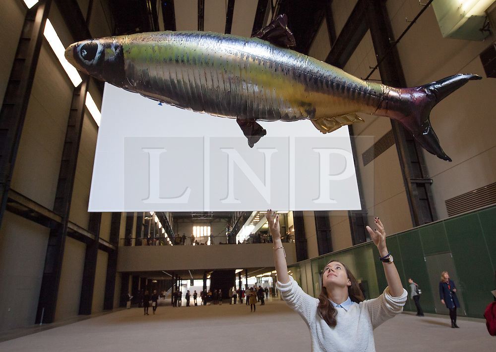 © Licensed to London News Pictures. 03/10/2016. London, UK. A woman interacts with the 'Anywhere' installation in the Tate Modern Turbine Hall by artist Philippe Parreno. Photo credit: Rob Pinney/LNP