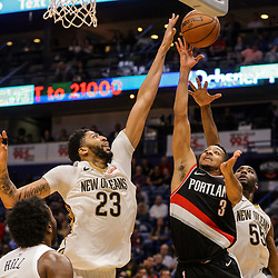 Mar 27, 2018; New Orleans, LA, USA; Portland Trail Blazers guard CJ McCollum (3) shoots over New Orleans Pelicans forward Anthony Davis (23) and forward E'Twaun Moore (55) during the second half at the Smoothie King Center. The Trail Blazers defeated the Pelicans 107-103. Mandatory Credit: Derick E. Hingle-USA TODAY Sports
