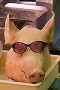 Face Off: Naha City Public Market. Pork, an Okinawa favourite. Pighead wearing sunglasses.