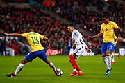 Brazil Paris Saint Germain PSG defender Marquinhos (13) stops England Manchester United midfielder Jesse Lingard (20)  during the International Friendly match between England and Brazil at Wembley Stadium, London, England on 14 November 2017. Photo by Simon Davies.