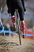 SHOT 1/12/14 1:19:20 PM - A Women's Elite racer sports some funny socks while warming up before the race at the 2014 USA Cycling Cyclo-Cross National Championships at Valmont Bike Park in Boulder, Co.  (Photo by Marc Piscotty / © 2014)