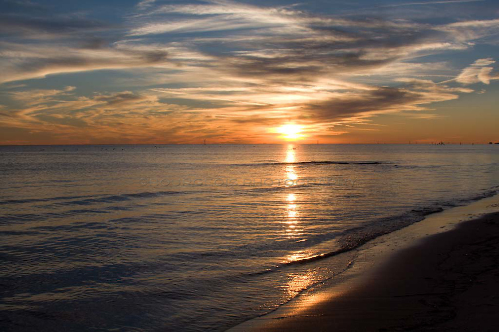 Sunset photo of the Biloxi Mississippi Gulf Coast beach.